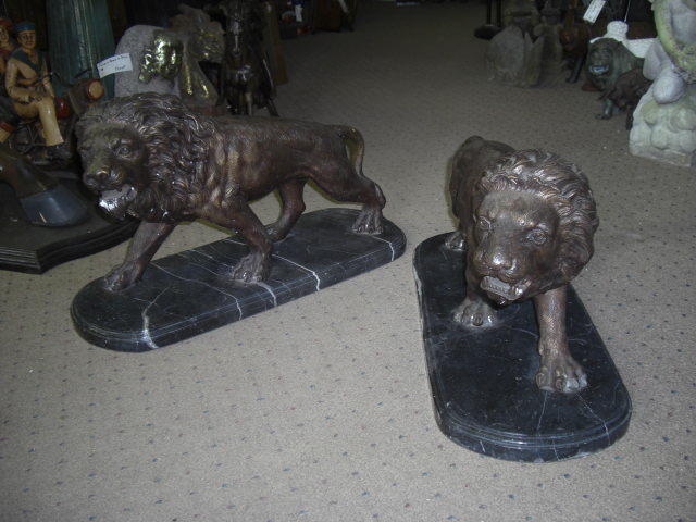 Pair of Bronze Lions on a Marble Base