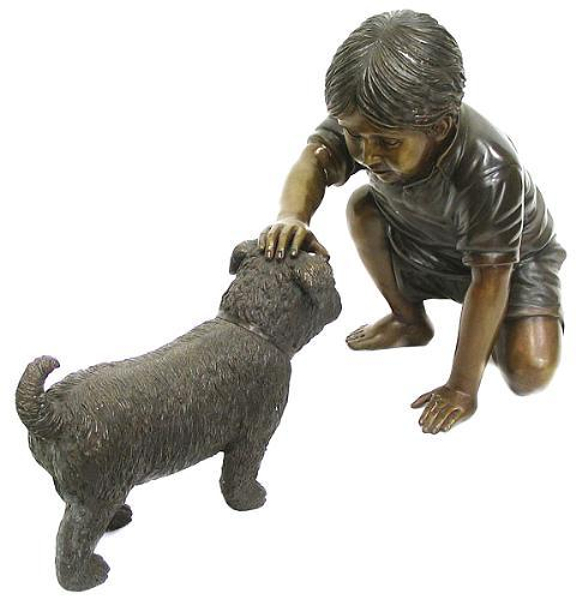 Bronze Boy Petting a Dog