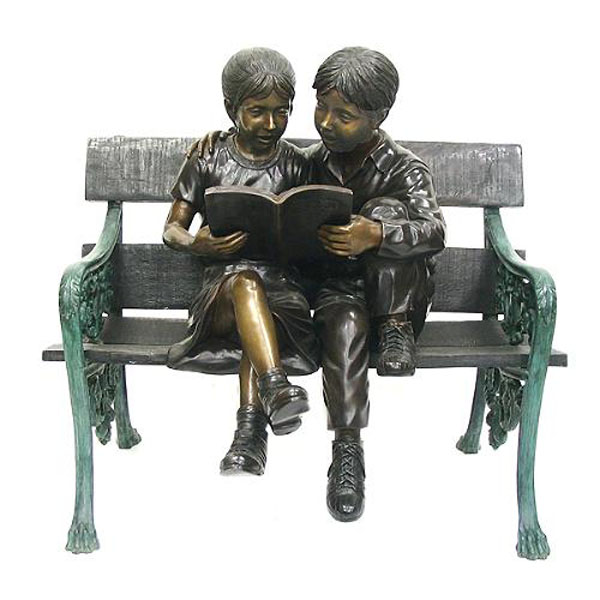 Bronze Kids sitting on a Bench Reading