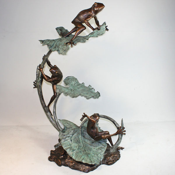 Bronze Frogs climbing on a Lily Pad Fountain